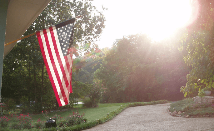 An American flag hanging outside a home