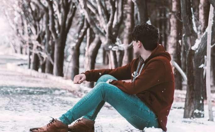 Man sitting on snowy ground
