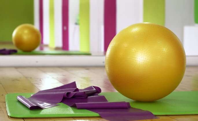 Yoga mat, exercise ball, and resistance band