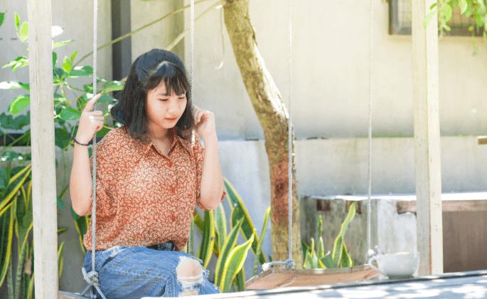 Woman sitting on swing