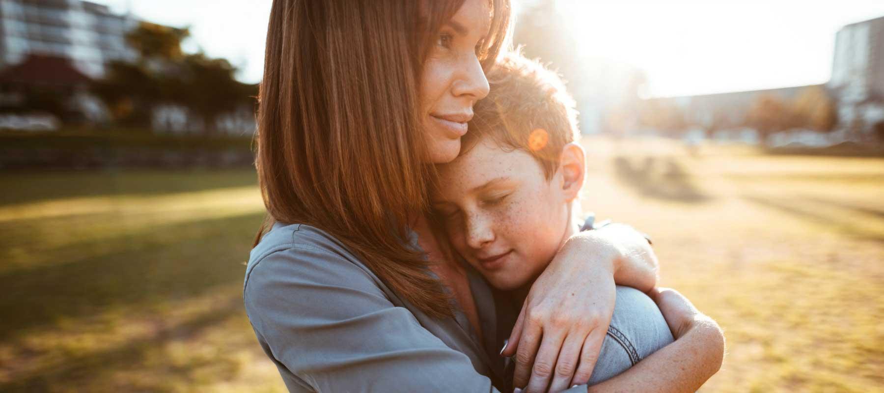 mother hugging son