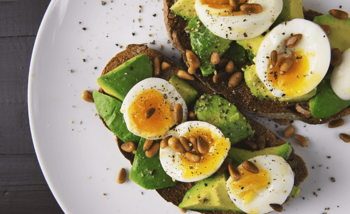 Toast topped with eggs and avocado