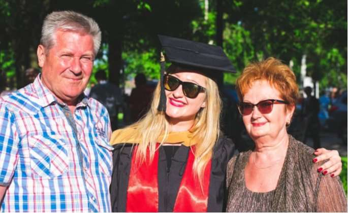Parents and daughter at graduation