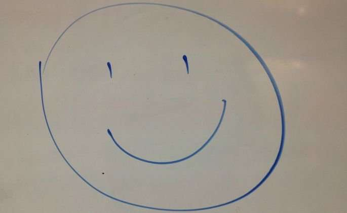 smiley face on whiteboard