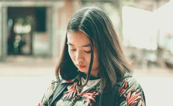 Contemplative Woman, Flower Shirt