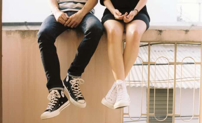 Couple sitting on ledge