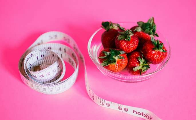 Strawberries and a tape measure