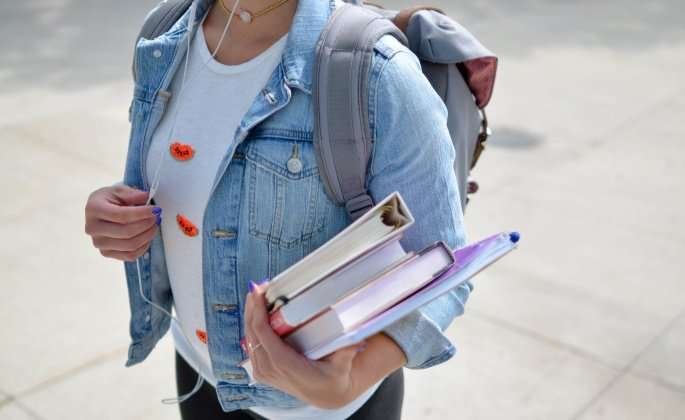 Teen with school books