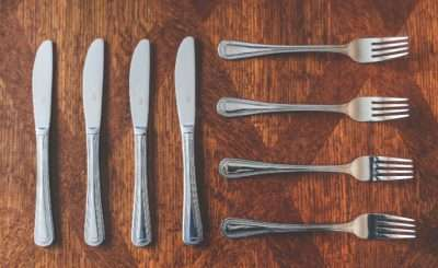 knives and forks on a table