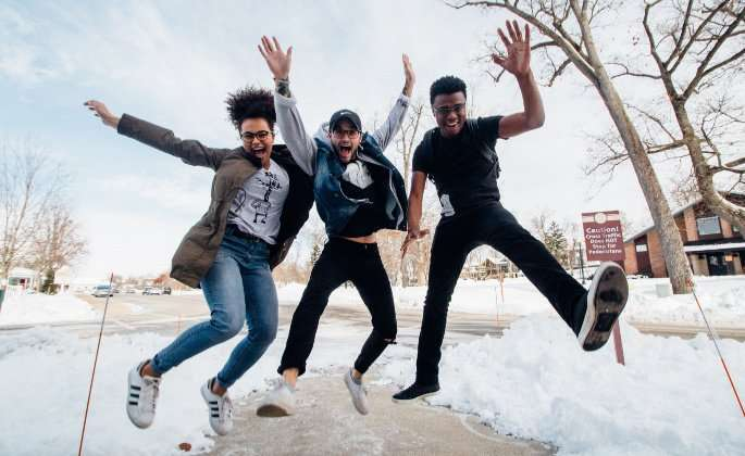 Three teens jumping
